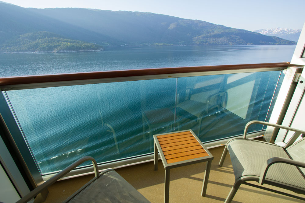 Balcony in cabin on cruise ship looking out to sea discussed in norwegian fjord cruise review