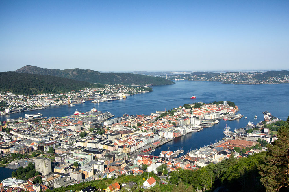 aerial view of the town of bergen with a cruise ship in harbour