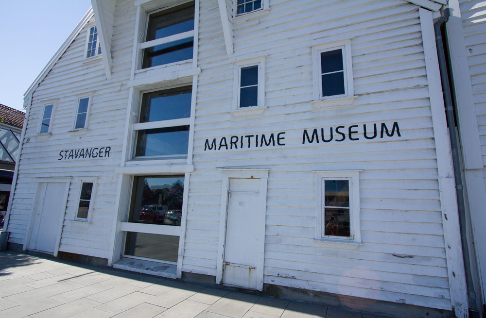 front of whoite wooden building of maritime museum in stavanger norway