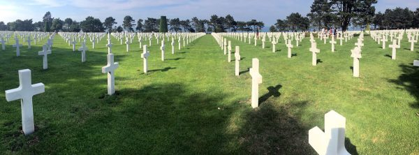 row of white crosses at normandy-american-cemetery that you can see when you visit omaha beach