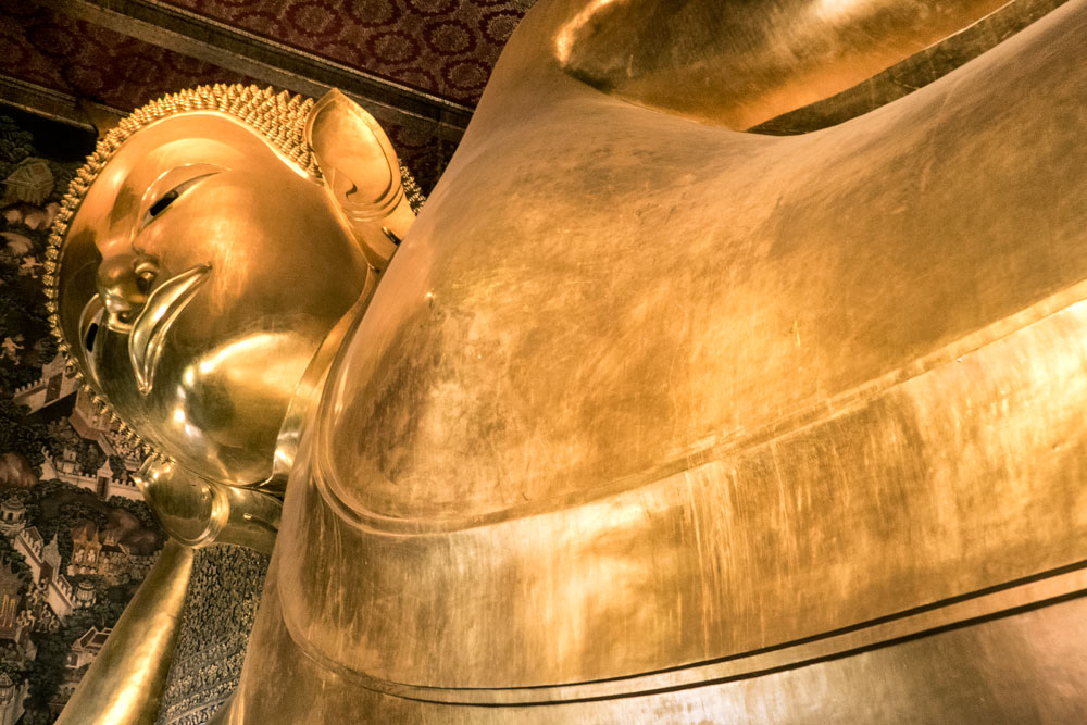 close up of reclining golden buddha