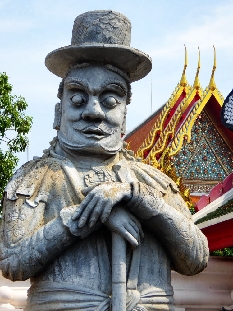 comical grey stone giant in bangkok temple
