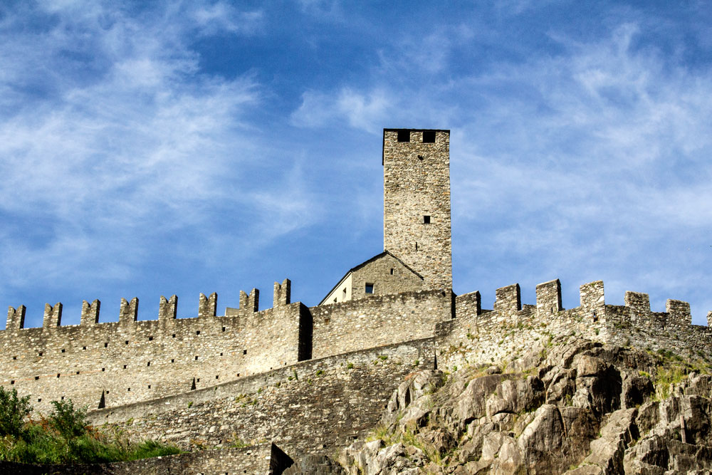 walls of old fortified castle with turret in bellinzona