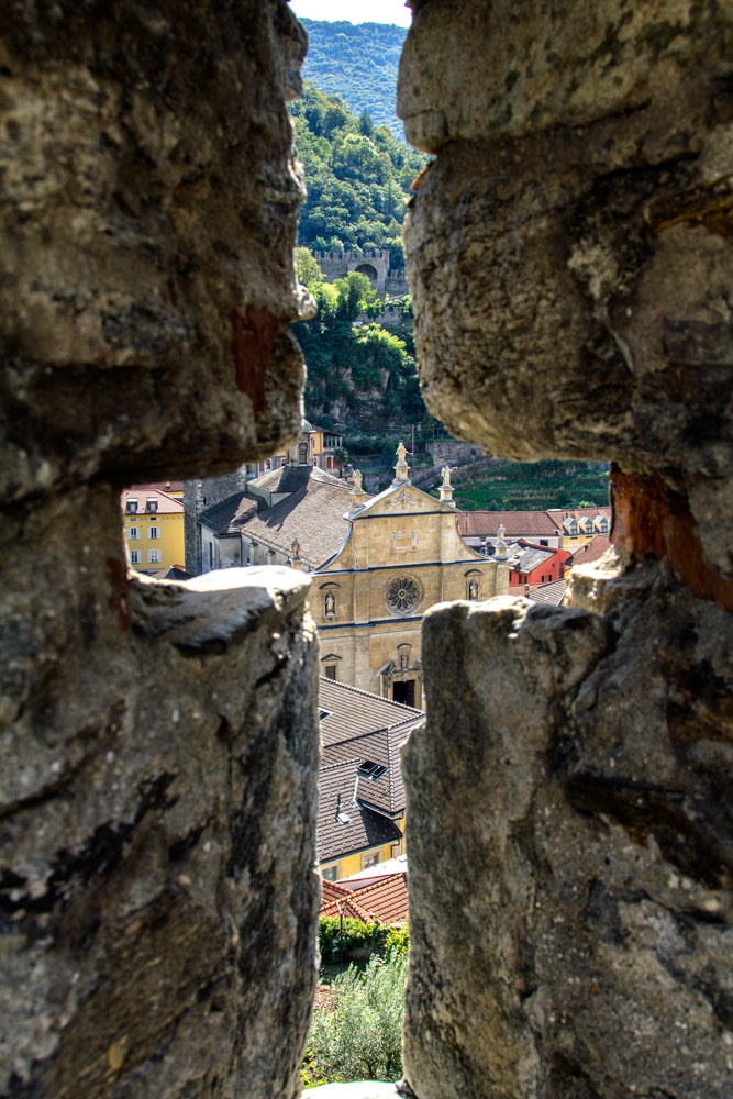 view of town on bellinzona through cross-shaped opening which is one place you can visit using the ticino ticket