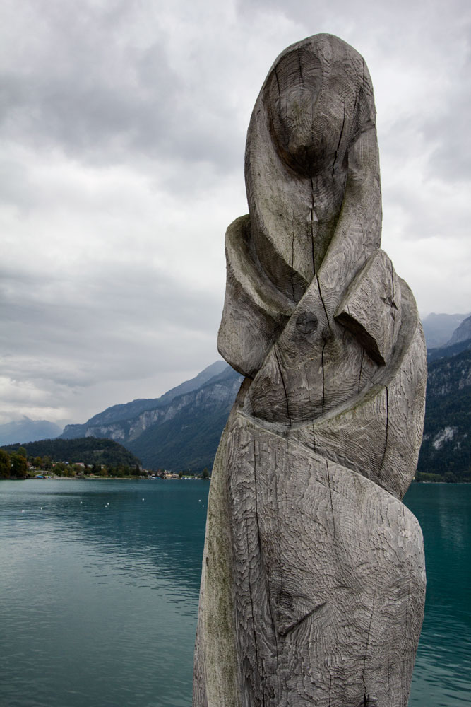 abstract sculpture of woman at lakeside