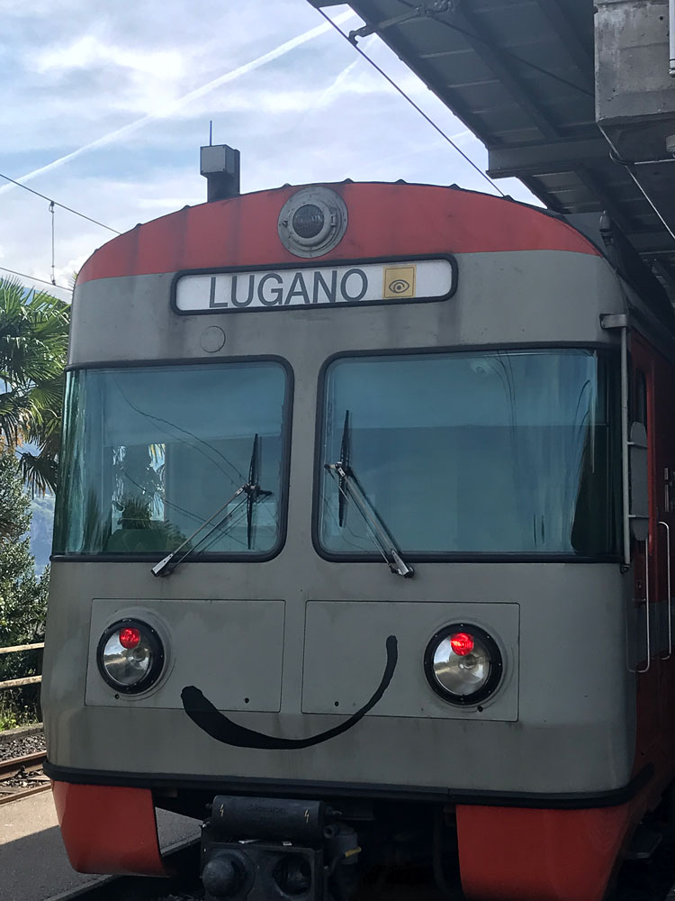 swiss train that can be used with the ticino ticket with a smiley face painetd on front