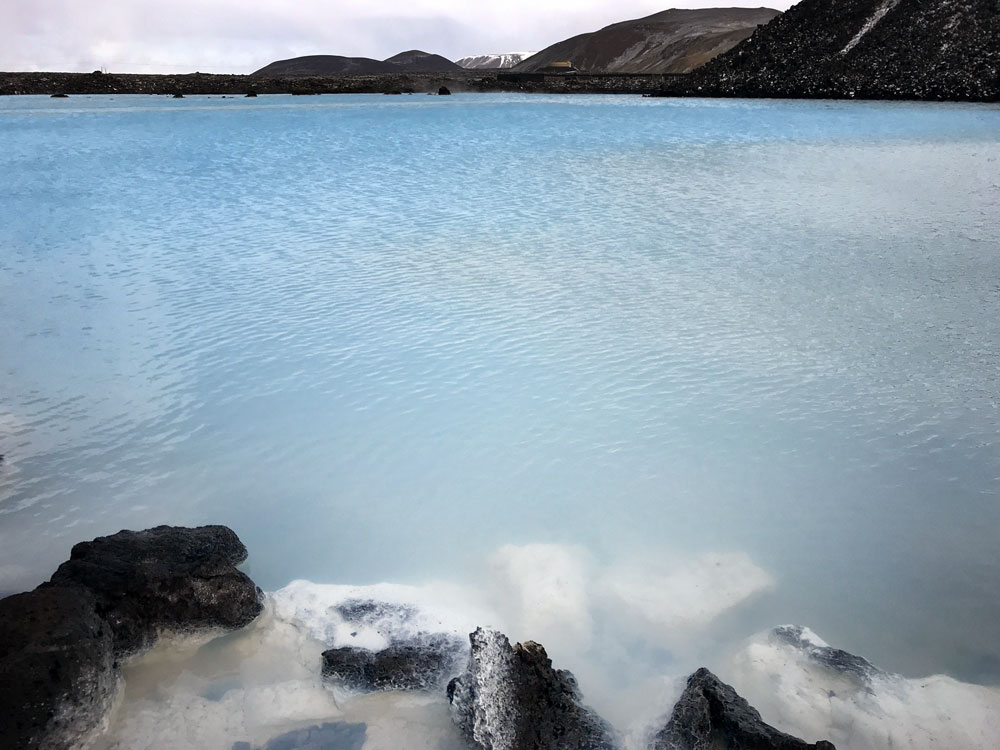 milky blue water of blue lagoon with rocks