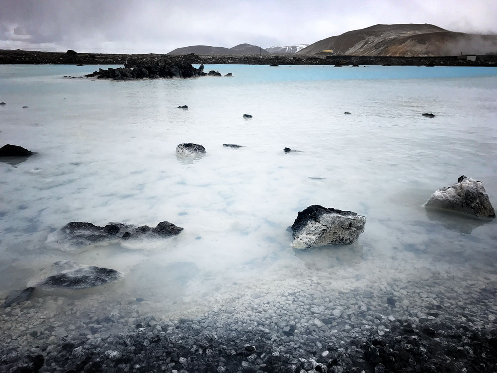 milky blue water and rocks of blue lagoon iceland