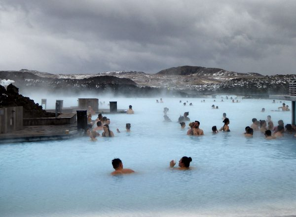 people bathing in milky water but is the blue lagoon worth it