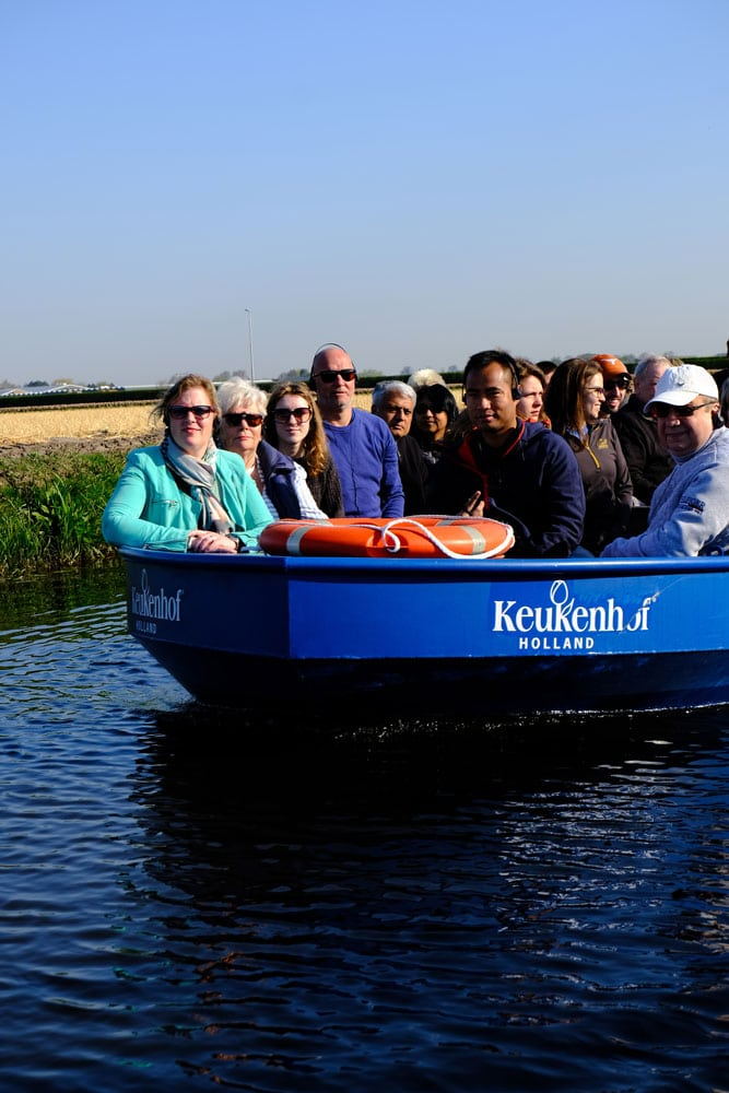 people in boat visiting keukenhof gardens