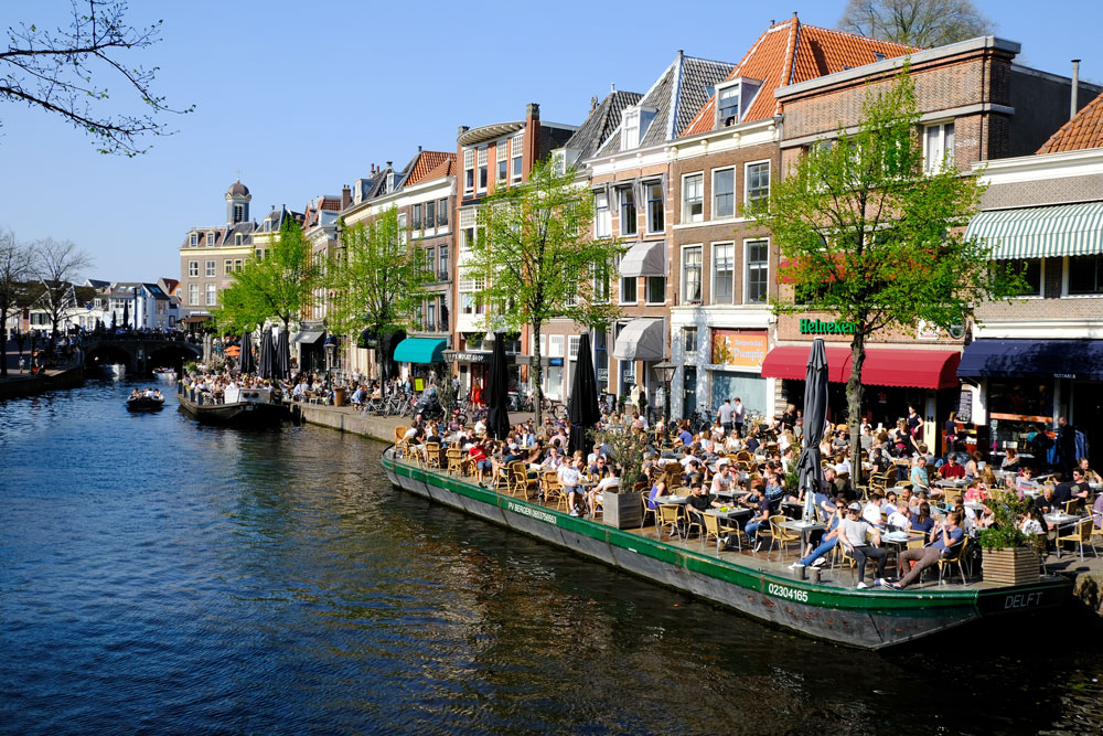 busy bars along a canalside in leiden