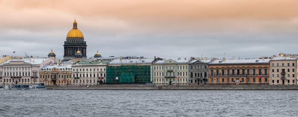 buildings along riverfront in st petersburg at sunset