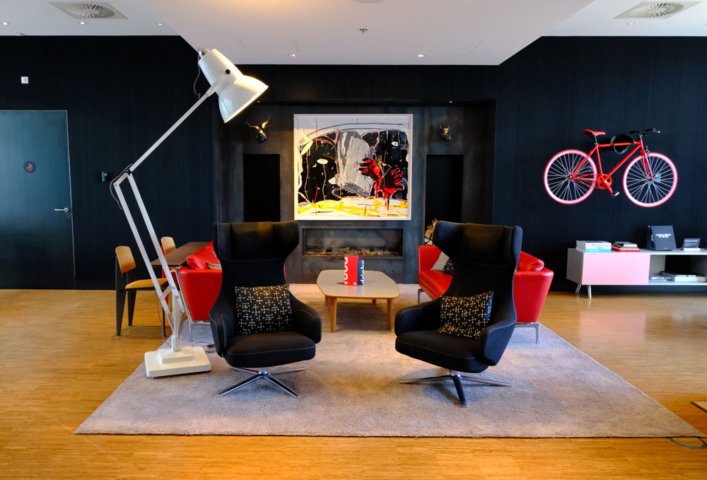 two chairs and a lamp as part ofOne of citizenM Rotterdam's living rooms
