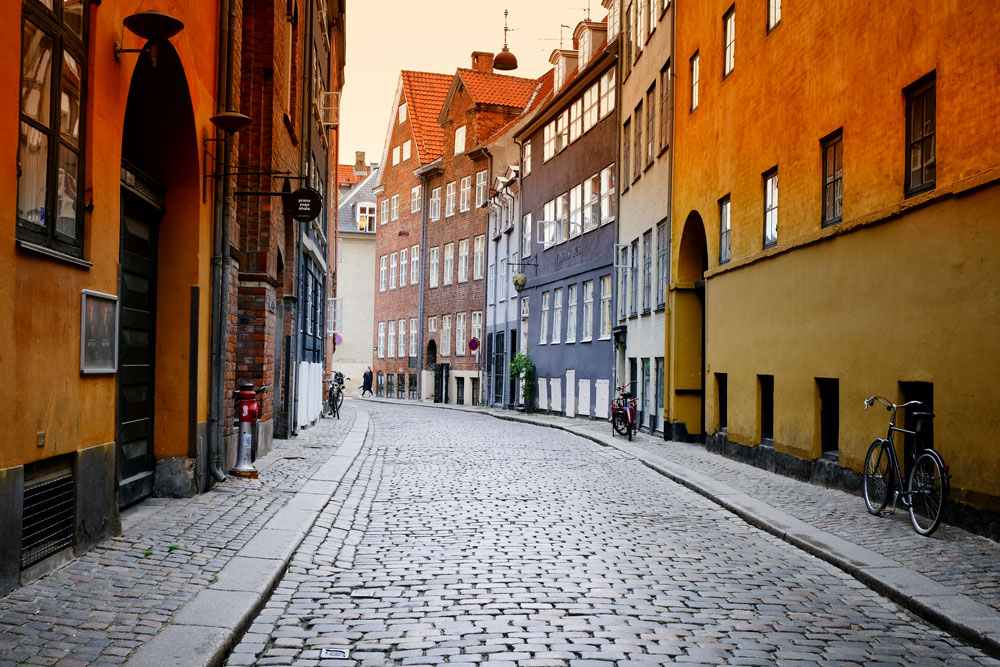 cobblestoned street with brightly coloured buildings