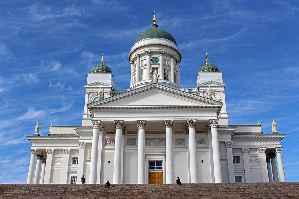steps leading to white facade of Lutheran Cathedral in helsinki