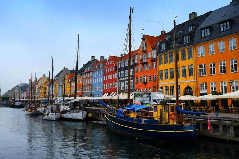 brightly colored buildings lining Nyhavn Copenhagen