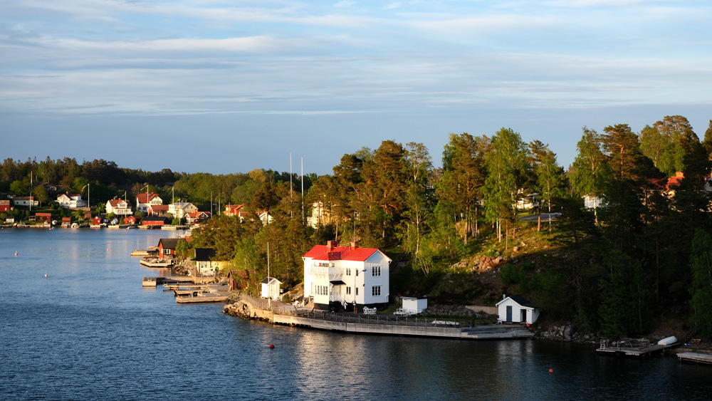 brightly coloured houses in island on stockholms archipelago