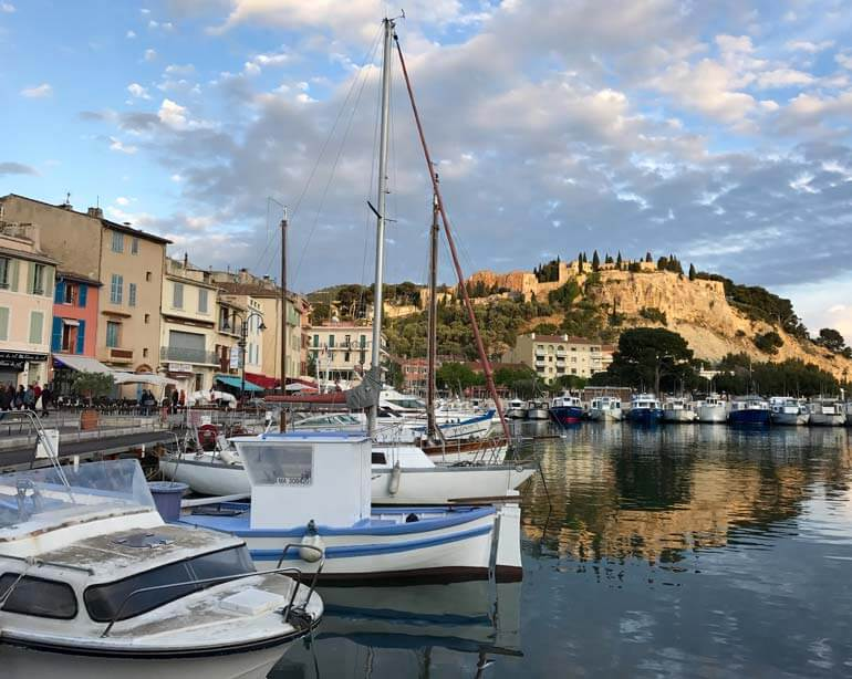 boats in the port of cassis-provence-overlooked by castle