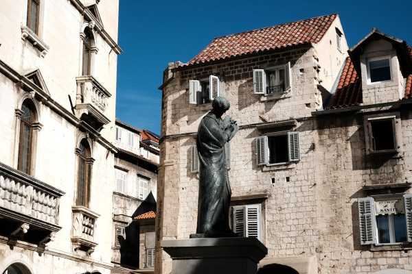 statue and houses in piazza in split old town seen when exploring diocletian's palace