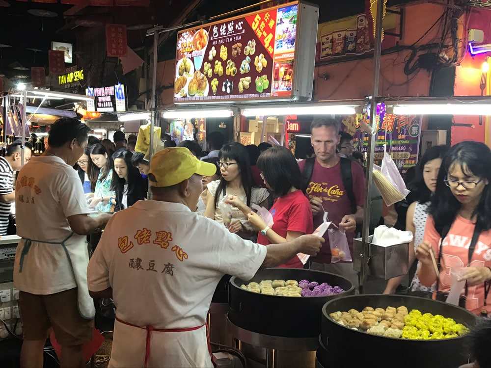 people being served at a hawker stall in malaysia