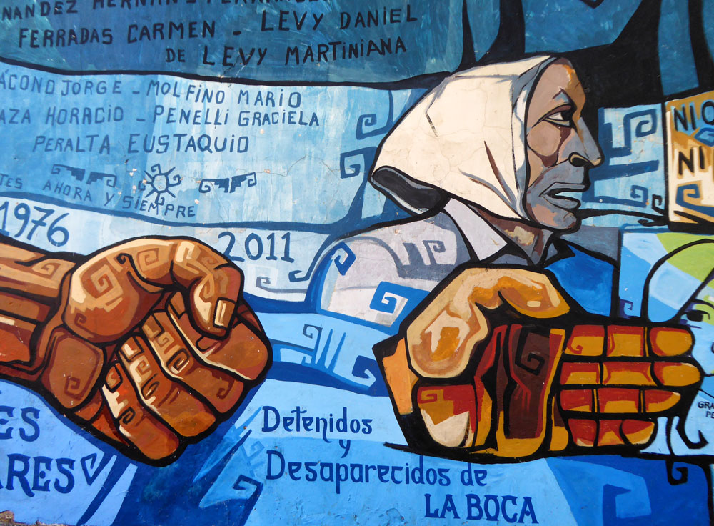 mural of a woman in scarf and clenched fist i