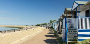 blue-and-white-beach-huts-in-a-seaside-town-in-kent