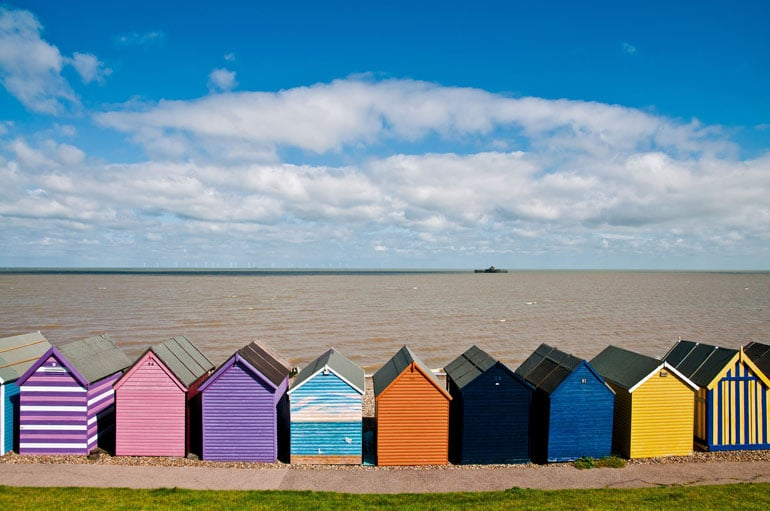 brightly-coloured-beach-huts-in-a-kent-seaside-town