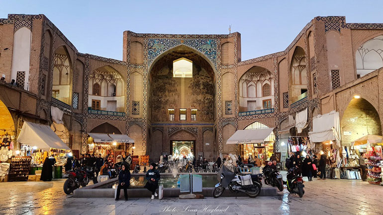 people-sitting-at-entrance-to-Gheysarieh-Bazar-Isfahan