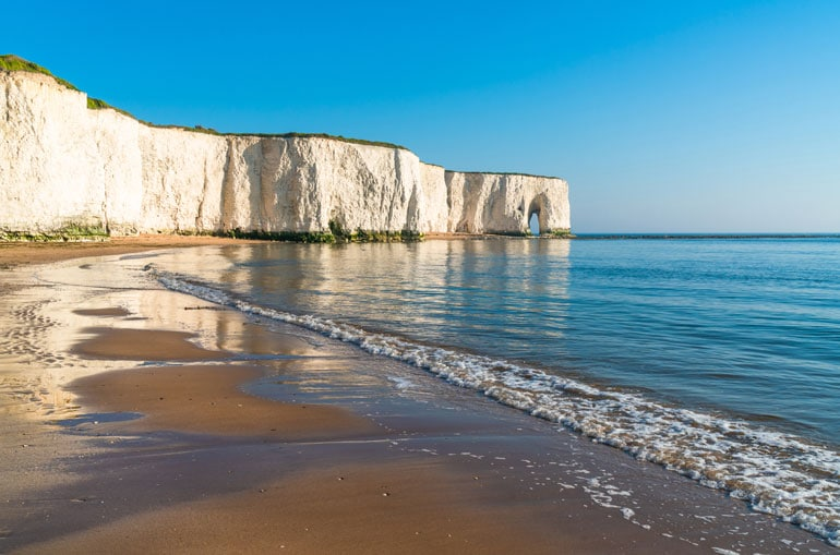 sandy-beach-against-a-cliff-face-and-sandy-beach-in-kent