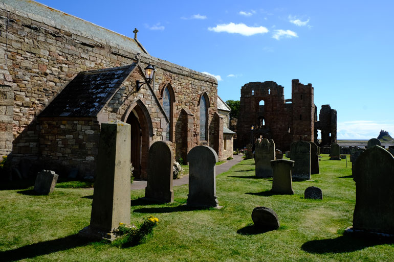 st-marys-church-with-lindisfarne-priory-and-castle-in-background