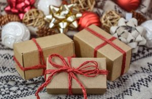 presents wrpped in brown paper and red string