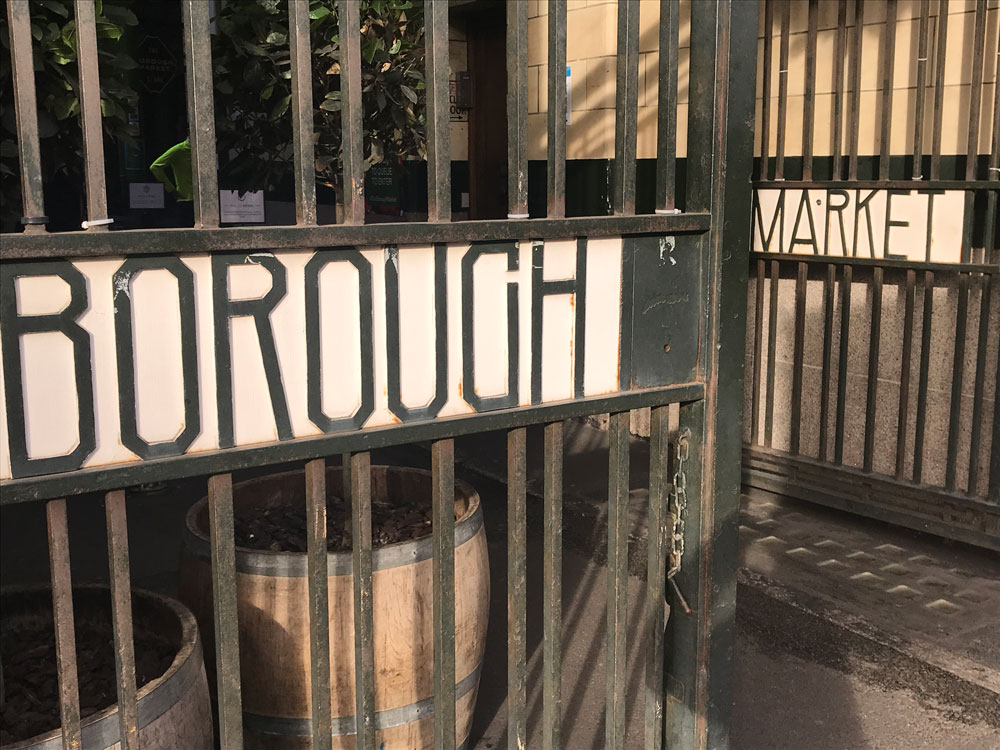 sign for borough market on open cast iron gate