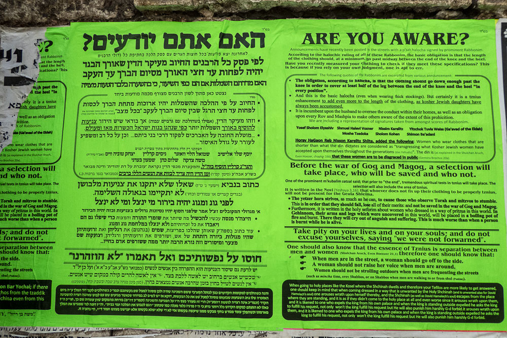 a modesty poster pasted on wall of mea shearim in jerusalem