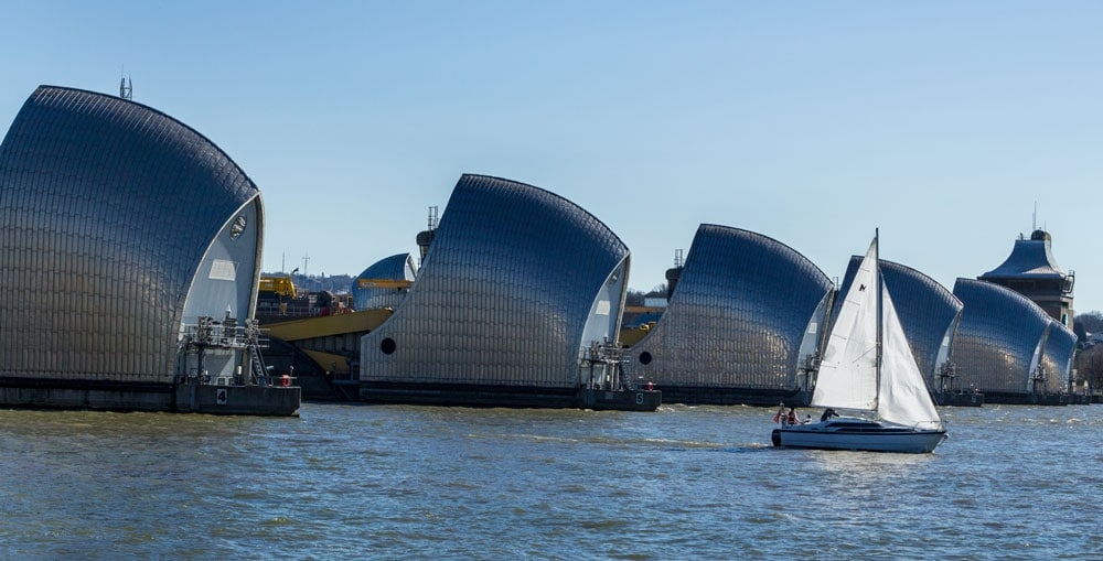 sailboat passing by the thames barrier london