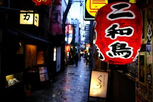 chinese lantern in cobblestone street in osaka at night
